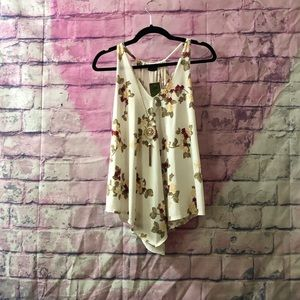 cream colored tank top with roses